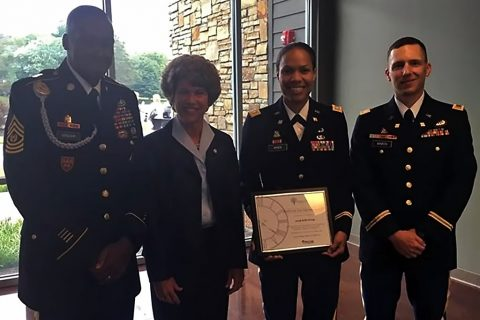 Left to right: Command Sgt. Maj. Frank Graham Jr., senior enlisted adviser for 101st Special Troops Battalion, 101st Airborne Division Sustainment Brigade, 101st Abn. Div. (Air Assault), Kim McMillan, mayor for the city of Clarksville, Tn., Lt. Col. Wally Vives-Ocasio, commander of the 101st STB, and 2nd Lt. Virgil A. Binion, executive officer for Charlie Detachment, 101st Financial Management Support Unit, 101st Abn. Div. Sust. Bde., take a photo together Sept. 1, 2016 after 101st STB received the Boots on ground award at the Partners in Education Breakfast at the Wilma Rudolph Event Center in Clarksville, TN. (Lt. Col. Wally Vives-Ocasio)