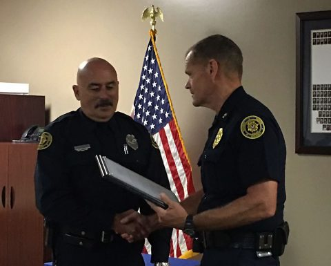 Officer Stanfill and Chief Ansley- Receiving the Retirement Certificate