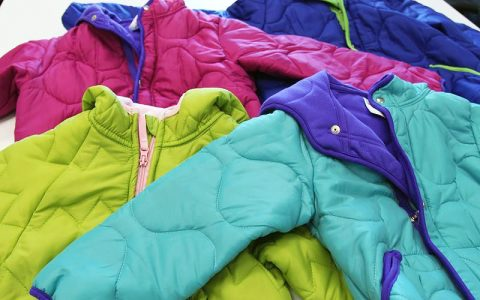 Local outreach provides new winter coats to local children through nonprofit organization