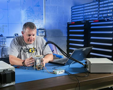 NASA Glenn engineer Norman Prokop refines microscope that could study Martian soil. (NASA)