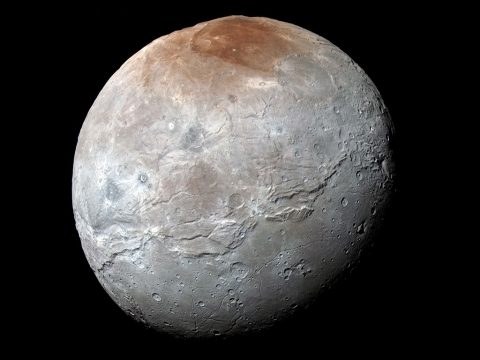 NASA's New Horizons spacecraft captured this high-resolution, enhanced color view of Pluto's largest moon, Charon, just before closest approach on July 14, 2015. The image combines blue, red and infrared images taken by the spacecraft's Ralph/Multispectral Visual Imaging Camera (MVIC); the colors are processed to best highlight the variation of surface properties across Charon. (NASA/JHUAPL/SwRI)