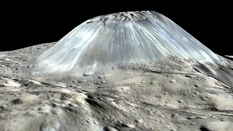 Ceres' lonely mountain, Ahuna Mons, is seen in this simulated perspective view. The elevation has been exaggerated by a factor of two. (NASA/JPL-Caltech/UCLA/MPS/DLR/IDA/PSI)