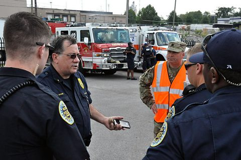 Metro Police Lt. Floyd Hyde briefs Tennessee National Guard Lt. Col Travis Powell, Safety Director, and other Metro Police Officers prior to the National Guard Active Aggressor Exercise yesterday at National Guard Headquarters on Sidco Drive.