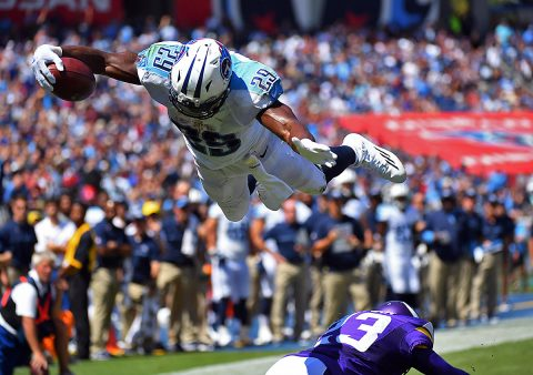 Tennessee Titans running back DeMarco Murray (29) leaps over Minnesota Vikings cornerback Terence Newman (23) for a touchdown during the first half at Nissan Stadium. (Christopher Hanewinckel-USA TODAY Sports)