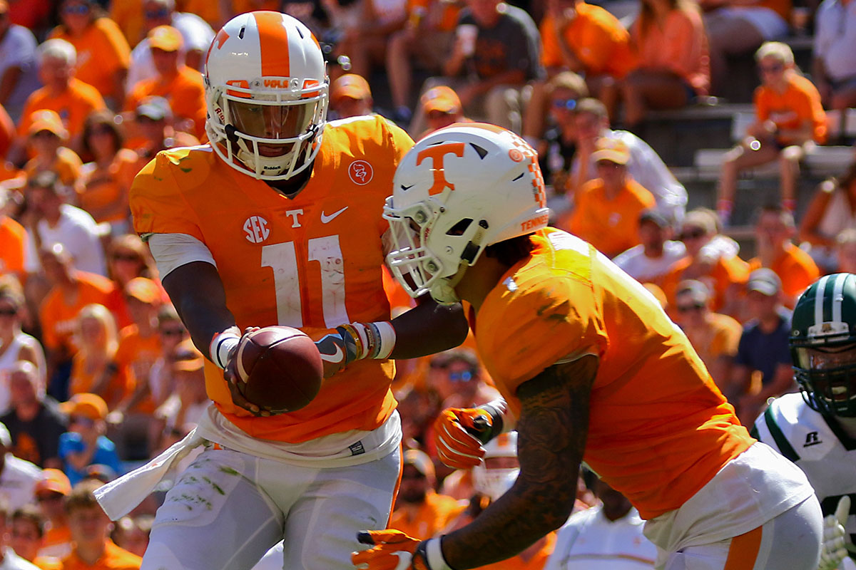 Tennessee Volunteers quarterback Joshua Dobbs (11) hands the ball off to running back Jalen Hurd (1) during the second half against the Ohio Bobcats at Neyland Stadium. Tennessee won 28 to 19. (Randy Sartin-USA TODAY Sports)