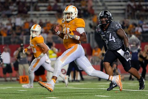 Tennessee Volunteers quarterback Joshua Dobbs (11) runs the ball against the Virginia Tech Hokies during the second half at Bristol Motor Speedway. Tennessee won 45 to 24. (Randy Sartin-USA TODAY Sports)