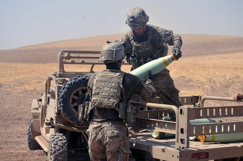 U.S. Army 1st Lt. Matthew Frank, right, a platoon leader with Battery C, 1st Battalion, 320th Field Artillery Regiment, Task Force Strike, hands an artillery round to Sgt. 1st Class Juan Burkett, left, during a fire mission in northern Iraq, Aug. 15, 2016, during an operation to support the Iraqi army. Battery C is supporting the Iraqi security forces with indirect fires as they retake territory from the Islamic State of Iraq and the Levant. (1st Lt. Daniel I Johnson/Released)