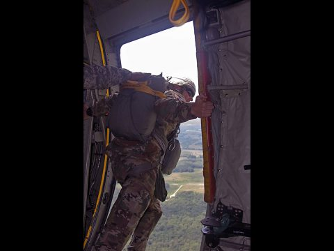 A jumpmaster with the 861st Quartermaster Company conducts his safety checks from the C-130 door over Fort Campbell, Kentucky, on Saturday, Aug. 27.