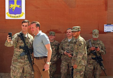 U.S. Army Capt. Thomas Izzo, fires support officer, Task Force Strike, Combined Joint Forces Land Component Command – Operation Inherent Resolve, takes a selfie with Secretary of the Army Eric Fanning while a group of Strike Soldiers await their opportunity to snap a photo with Fanning at Camp Swift, Iraq, Sept. 18, 2016. This was the second day of Fanning's tour through Iraq, where he visited Soldiers assigned to the Combined Joint Forces Land Component Command – Operation Inherent Resolve to garner firsthand feedback from troops on the ground. (Sgt. 1st Class R.W. Lemmons)