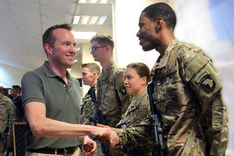 Secretary of the Army Eric Fanning presents a coin for excellence to Cpl. Patrick Harris, a culinary specialist, Headquarters Support Company, 101st Airborne Division (Air Assault), at Forward Operating Base Union III, Iraq, Sept. 17, 2016. Union III was Fanning's first stop in his tour of Iraq where he met with leadership and engaged with Soldiers assigned to the Combined Joint Forces Land Component Command – Operation Inherent Resolve. (Sgt. 1st Class R.W. Lemmons IV)