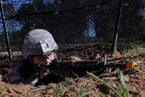Pvt. Anthony Ennist, a light-wheeled vehicle mechanic with 584th Support Maintenance Company, 129th Combat Sustainment Support Battalion, 101st Airborne Division (Air Assault) Sustainment Brigade, 101st Abn. Div., pulls guard in his foxhole, Sept. 27, 2016, during his company field training exercise on Fort Campbell, Ky. (Pfc. Tyler Owen/ 129th Combat Sustainment Support Battalion UPAR)