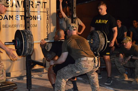 Soldiers and leaders with Task Force Strike gather to take part in the 1000-pound club competition Aug. 7, 2016, at Camp Swift, Iraq. The goal of the weightlifting tournament was to motivate Soldiers to give them goals to work toward and build morale. (Maj. Ireka Sanders)