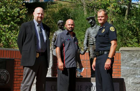 Tyler Barrett Memorial Ride and Check Presentation. (l to r) Detective Dennis Honholt, Erik Ranallo, and Chief Al Ansley.