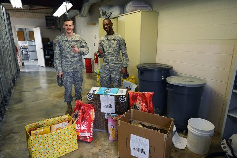 PF2 Goodson and SPC Humphrey who work with the Fort Campbell Stray Impound, were eager to accept the items donated by Campbell Crossing.