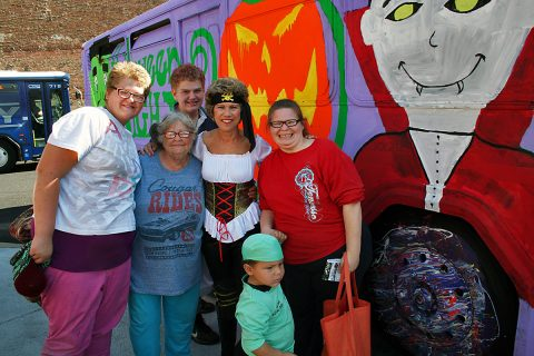Clarksville Mayor Kim McMillan gets ready to board the Spooky Special with a group of Clarksville Transit System passengers Saturday at the Transit Center.