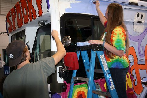Clarksville Academy art students put the finishing touches on last year's Spooky Special bus.