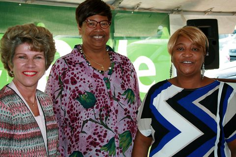 Clarksville Mayor Kim McMillan greets Angela Moore and Monalisa Barker, both of Clarksville, at the grand opening ceremony for the new Park & Ride at Exit 11. Moore and Barker ride the RTA's 94X Express bus to and from work and say the service eliminates the stress and expense of driving and parking in Nashville.
