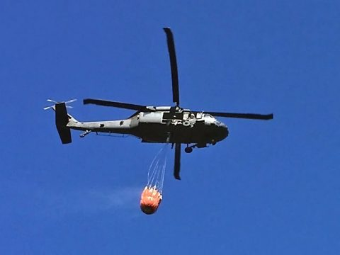 A Tennessee Army Guard Blackhawk Helicopter equipped with a Bambi Bucket conducts aerial firefighting on Signal Mountain, near Chattanooga on October 11, 2016. (Tennessee Forestry Division)