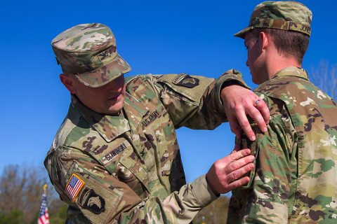 """Col. Stanley Sliwinski, commander of the 101st Airborne Division Sustainment Brigade """"Lifeliners,"""" 101st Abn. Div. (Air Assault), places the 101st Abn. Div. patch on a Soldier from 1176th Transportation Company, Oct. 23, 2016, during the companies patching ceremony in Smyrna, TN. (Sgt. Neysa Canfield/ 101st Airborne Division Sustainment Brigade Public Affairs)"""