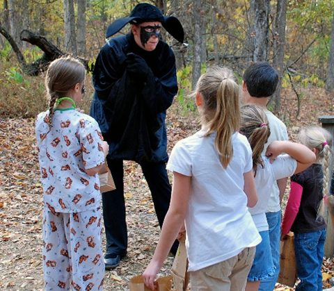 Otis the Bat talks with children along the trail and explains his role in the forest during the Howl-O-Ween program at Land Between the Lakes. (Nature Station staff)