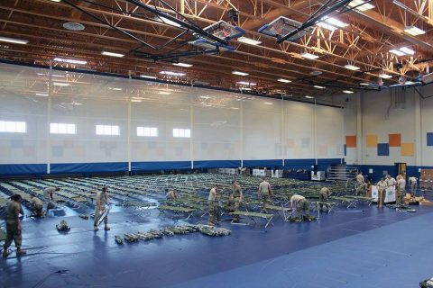 Army National Guard and Reserve Soldiers set up cots at Denich Gym in preparation of Hurricane Matthew to hit Naval Station Guantanamo Bay, October 3rd Approximately 700 spouses and children were evacuated to Naval Air Station Pensacola, Fla. Hurricane Condition of Readiness I (COR I) was set base-wide and all residents should be sheltering in place or moved to their emergency shelter location. (U.S. Navy photo courtesy of Army Capt. Frederick H. Agee/Released)