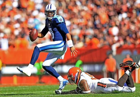 Tennessee Titans quarterback Marcus Mariota (8) gets away from a Cleveland Browns defender during the fourth quarter at FirstEnergy Stadium. (Andrew Weber-USA TODAY Sports)
