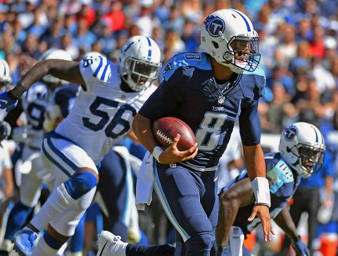 Tennessee Titans quarterback Marcus Mariota (8) runs for a first down in the first half against the Tennessee Titans at Nissan Stadium. The Colts won 34-26. (Christopher Hanewinckel-USA TODAY Sports)