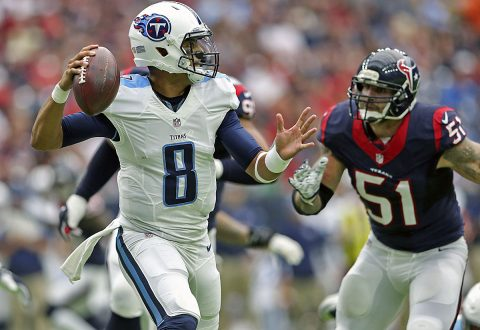 Tennessee Titans quarterback Marcus Mariota (8) throws as Houston Texans outside linebacker John Simon (51) rushes during the first half at NRG Stadium. (Kevin Jairaj-USA TODAY Sports)