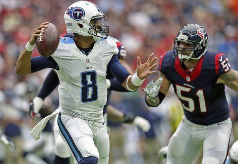 Tennessee Titans quarterback Marcus Mariota (8) throws as Houston Texans outside linebacker John Simon (51) rushes during the first half at NRG Stadium. (Kevin Jairaj-USA TODAY Sports)