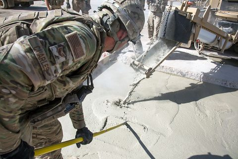 U.S Air Force Staff. Sgt. Tyler Charles, assigned to the 1st Expeditionary Civil Engineering Group, levels poured concrete into a trench at Qayyarah West airfield, Iraq, Oct. 8, 2017. A Coalition of regional and international nations have joined together to enable Iraqi forces to counter ISIL, reestablish Iraq's borders and re-take lost terrain thereby restoring regional stability and security. (Spc. Christopher Brecht)