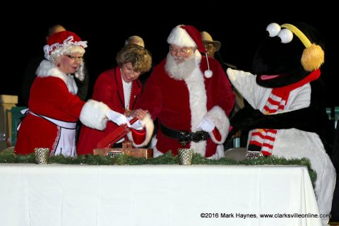 Mrs. Claus, Clarksville Mayor Kim McMillan, Santa Claus and Snow Bird flip the switch officially turning on the lights for Christmas on the Cumberland.