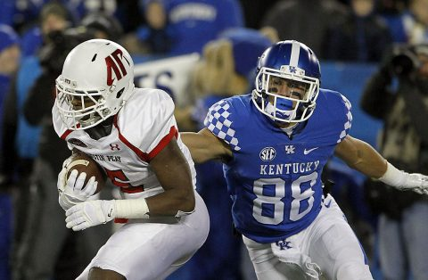 Austin Peay Governors wide receiver Kentel Williams (5) runs the ball against Kentucky Wildcats wide receiver Charles Walker (88) in the first half at Commonwealth Stadium. (Mark Zerof-USA TODAY Sports)