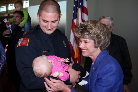 Clarksville Mayor Kim McMillan smiles at Lexie Huff, infant daughter of newly sworn Clarksville Firefighter Matt Huff. Lexie was born on Huff's third day at the fire academy earlier this year. Huff was among 19 new firefighters who took the Clarksville Fire Rescue service oath Friday.