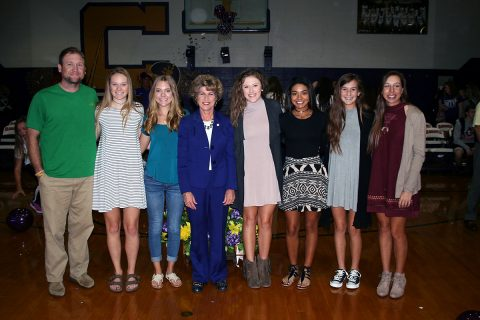 Clarksville Mayor Kim McMillan celebrates with the state championship CHS Girls Golf Team.