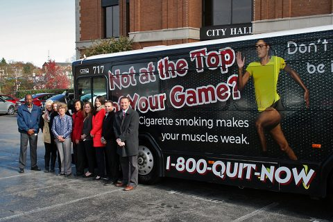 Mayor Kim McMillan, CTS Director Arthur Bing Sr., MCHD Director Joey Smith and members of the MCHD Heath Education Team join in the unveiling of a CTS bus newly wrapped in anti-smoking messages. Funding for the effort comes from the Tennessee Health Department's allocation of money from a tobacco lawsuit settlement.