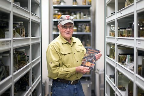 "Retired Austin Peay professor Dr. Floyd Scott with the book ""Amphibians and Reptiles of Land Between the Lakes."""