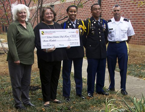 (From left to Right) Montgomery County Sheriff Deputy Peggy Macias, SafeHouse representative Diane Herndon, JROTC Cadet Lt. Col. Kelsey Thornton (Battalion Commander), JROTC Cadet Major Aaron Rice (Executive Officer) and JROTC instructor Edward Coleman (CW3 Retired).