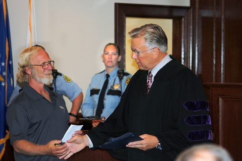 Montgomery County Veterans Treatment Court (VTC) for Life member Dean Viertel accepting his certificate from VTC Judge Kenneth Goble Jr.