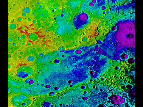 "Using colorized topography, Mercury's ""great valley"" (dark blue) and Rembrandt impact basin (purple, upper right) are revealed in this high-resolution digital elevation model merged with an image mosaic obtained by NASA's MESSENGER spacecraft.(NASA/JHUAPL/Carnegie Institution of Washington/DLR/Smithsonian Institution)"