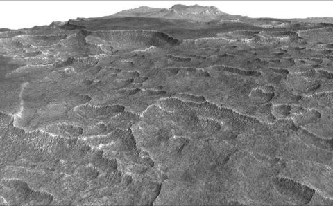 This vertically exaggerated view shows scalloped depressions in a part of Mars where such textures prompted researchers to check for buried ice, using ground-penetrating radar aboard NASA's Mars Reconnaissance Orbiter. (NASA/JPL-Caltech/Univ. of Arizona)