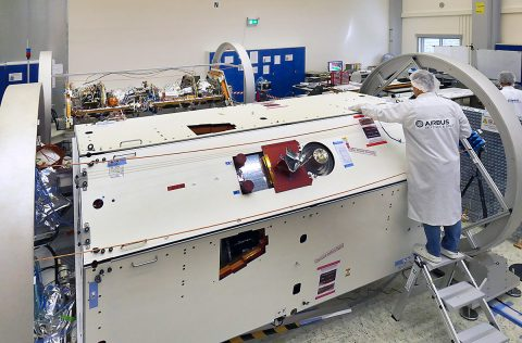 A technician inspects one of the two satellites for NASA's Gravity Recovery and Climate Experiment Follow-On (GRACE-FO) mission at the Airbus Defence and Space manufacturing facility in Friedrichshafen, Germany. The other GRACE-FO satellite is visible in the background. (Airbus DS GmbH-A.Ruttloff 2016)