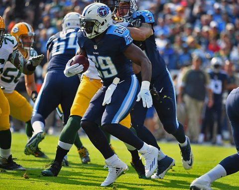 Tennessee Titans running back DeMarco Murray (29) breaks through the line and scores a touchdown during the first half against the Green Bay Packers at Nissan Stadium. (Christopher Hanewinckel-USA TODAY Sports)