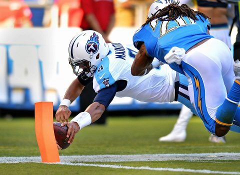 Tennessee Titans quarterback Marcus Mariota (8) dives in for a third quarter touchdown as San Diego Chargers free safety Dwight Lowery (20) defends at Qualcomm Stadium. (Jake Roth-USA TODAY Sports)