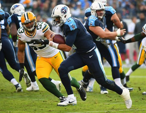 Tennessee Titans quarterback Marcus Mariota (8) runs for a short gain during the second half against the Green Bay Packers at Nissan Stadium. The Titans won 47-25. (Christopher Hanewinckel-USA TODAY Sports)