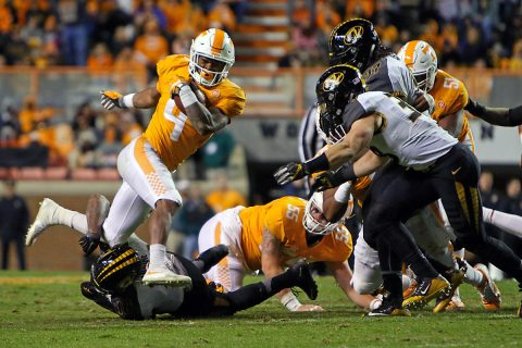 Tennessee Volunteers running back John Kelly (4) runs the ball against the Missouri Tigers during the second half at Neyland Stadium. Tennessee won 63-37. (Randy Sartin-USA TODAY Sports)