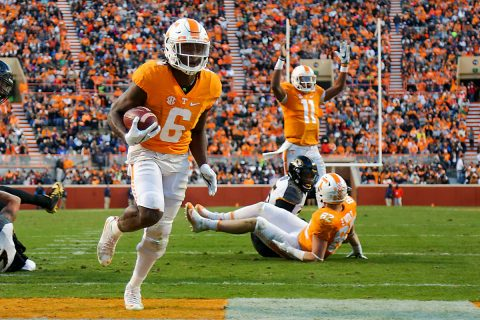 Tennessee Volunteers quarterback Joshua Dobbs (11) signals a touchdown as Tennessee Volunteers running back Alvin Kamara (6) scores against the Missouri Tigers during the second quarter at Neyland Stadium. (Randy Sartin-USA TODAY Sports)
