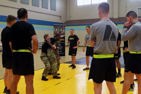 Sgt. Whitney Conder and Sgt. Spenser Mango, both wrestlers with the U.S. Army World Class Athlete Program, demonstrate take down techniques to Soldiers of 101st Airborne Division (Air Assault) Sustainment Brigade, 101st Abn. Div., Nov. 15, 2016 at Shaw Physical Fitness Center on Fort Campbell, Ky. (Sgt. Neysa Canfield/101st Airborne Division Sustainment Brigade Public Affairs)