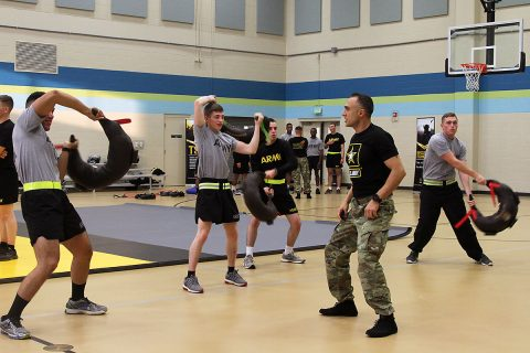 Sgt. Ali Asgary, the wrestling assistant coach with the U.S. Army World Class Athlete Program, shows Soldiers of 101st Airborne Division (Air Assault) Sustainment Brigade, 101st Abn. Div., the proper stance when training with a Bulgarian training bag, Nov. 15, 2016, at Shaw Physical Fitness Center on Fort Campbell, Ky. (Sgt. Neysa Canfield/101st Airborne Division Sustainment Brigade Public Affairs)