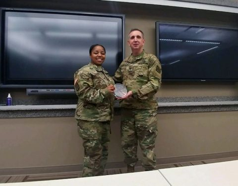 Sgt. 1st Class Ashley Davis (left), the Sexual Assault Response Coordinator for the 101st Airborne Division (Air Assault) Sustainment Brigade, 101st Abn. Div., receives the Sexual Harassment/Assault Response and Prevention Program Spirit Award at Sexual Assault Response Coordinator/Victim Advocate Career Course, at Fort Leavenworth, Kansas. (Sgt. 1st Class Ashley Davis)