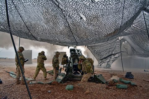 U.S Army Soldiers with Battery C, 1st Battalion, 320th Field Artillery Regiment, Task Force Strike, execute a fire mission to support the Iraqi security forces during the Mosul counter offensive, Dec. 24, 2016, in northern Iraq. Battery C is supporting the ISF with indirect fires in their fight against the ISIL. (U.S Army Photo by 1st Lt. Daniel Johnson)